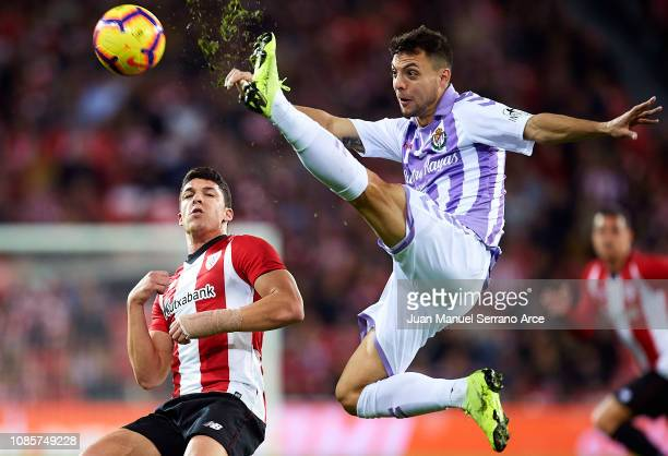 Oscar Plano of Real Valladolid CF competes for the ball with Ander Capa of Athletic Club during the La Liga match between Athletic Club and Real...
