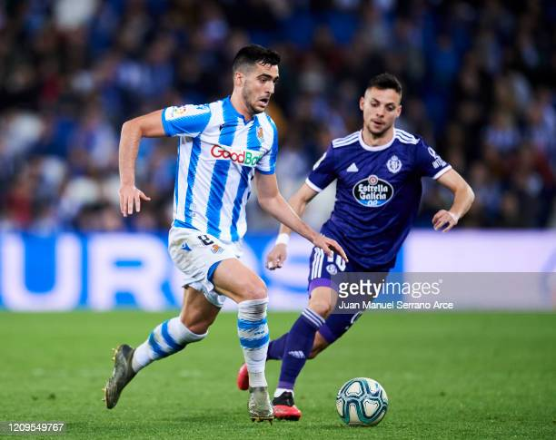 Oscar Plano of Real Valladolid CF duels for the ball with Mikel Merino of Real Sociedad during the Liga match between Real Sociedad and Real...