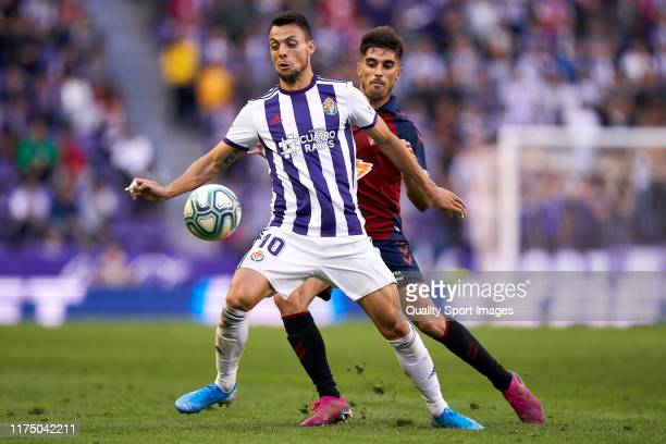 Oscar Plano of Valladoid CF battle for the ball with Nacho Vidal of CA Osasuna during the Liga match between Real Valladolid CF and CA Osasuna at...