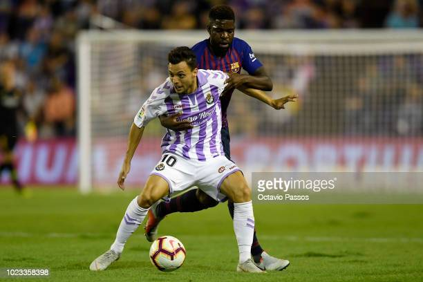 Oscar Plano of Valladolid competes for the ball with Samuel Umtiti of Barcelona during the La Liga match between Real Valladolid CF and FC Barcelona...