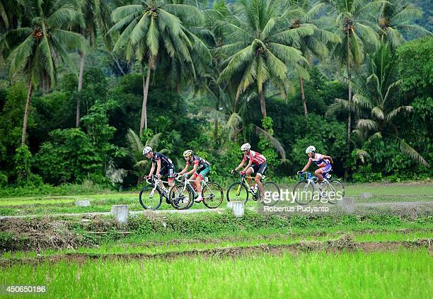 Oscar Pujol Munoz of Skydive Dubai Pro Cycling Team leads follow by Edgar Nohales Nieto of Team 7 Eleven Roadbike Phillipine Hari Fitriyanto of...