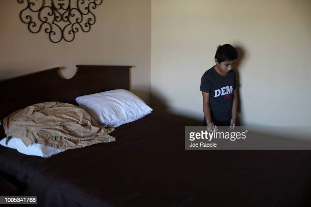 Oscar relaxes in the room he and his father were staying in as they are cared for in an Annunciation House facility after they were reunited on July...