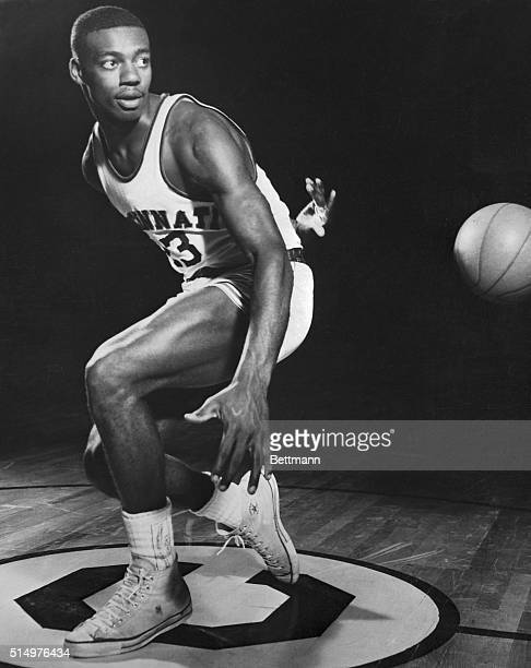 Oscar Robertson, college basketball player, is shown throwing the ball behind his back.