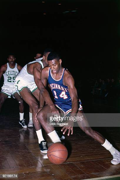 Oscar Robertson of the Cincinnati Royals drives to the basket against the Boston Celtics during a game played in 1964 at the Boston Garden in Boston,...