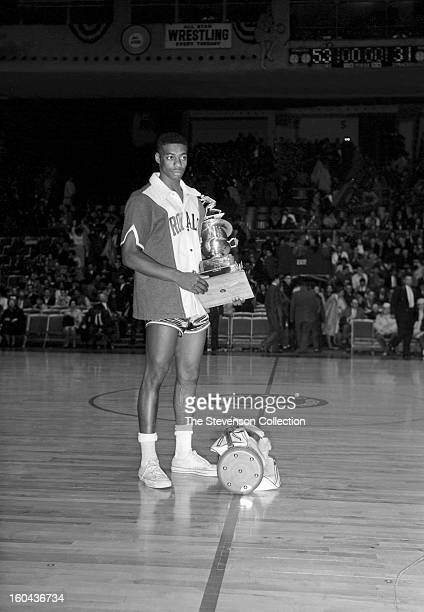 Oscar Robertson of the Cincinnati Royals is awarded the 1961 NBA All-Star MVP Trophy after the 1961 NBA All-Star Game circa 1961 in Syracuse, New...