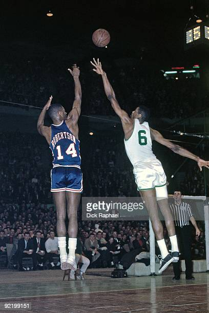 Oscar Robertson of the Cincinnati Royals shoots a jump shot over Bill Russell of the Boston Celtics during a game played in 1964 at the Boston Garden...