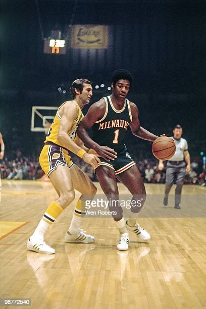 Oscar Robertson of the Milwaukee Bucks moves the ball up court against Jerry West of the Los Angeles Lakers during a game played circa 1971 at the...