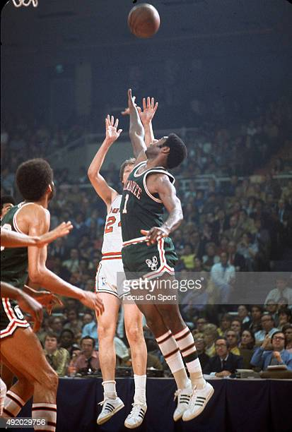 Oscar Robinson of the Milwaukee Bucks jumps at the shot of Jack Marin of the Baltimore Bullets during an NBA basketball game circa 1971 at the...