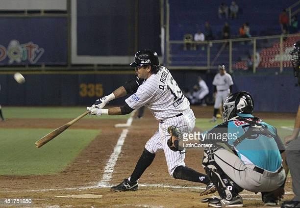 Oscar Robles hits the ball during a match between Saraperos de Saltillo and Guerreros de Oaxaca as part of the Mexican Baseball League 2014 at...