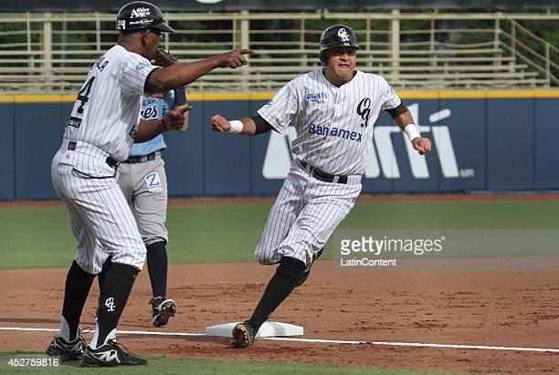 Oscar Robles of Guerreros runs to the third base during a match between Tigres de Quintana Roo and Guerreros de Oaxaca as part of the Mexican...