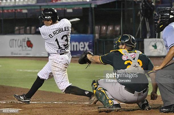 Oscar Robles of Guerreros swings the ball during a match between Olmecas de Tabasco and Guerreros de Oaxaca as part of the Mexican Baseball League...