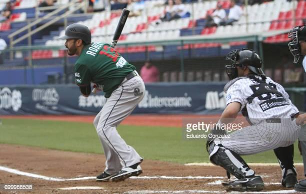 Oscar Robles of Toros de Tijuana swings the bat during the match between Toros de Tijuana and Guerreros de Oaxaca as part of the Liga Mexicana de...