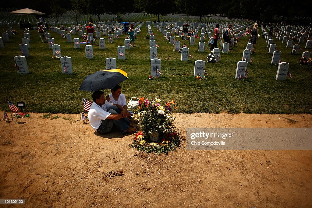 Oscar Rodriguez (L) and his wife Mary Rodriguez of Fairfax, Virginia, sit next to the fresh gravesite of their nephew, U.S. Marine Corps Corporal Nicolas Parada-Rodriguez, on Memorial Day in Section 60 of Arlington National Cemetery May 31, 2010 in Arlington, Virginia. Corporal Rodriguez was shot and killed by a sniper May 16, 2010 while serving in Kandahar, Afghanistan and was buried at Arlington last Thursday, May 27, 2010.