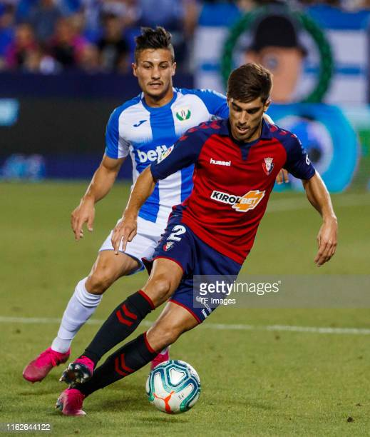 Oscar Rodriguez of CD Leganes and Nacho Vidal of CA Osasuna battle for the ball during the Liga match between CD Leganes and CA Osasuna at Estadio...