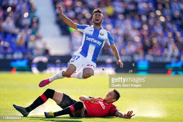 Oscar Rodriguez of CD Leganes battle for the ball with Railo of RCD Mallorca during the Liga match between CD Leganes and RCD Mallorca at Estadio...