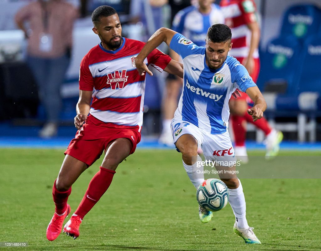 Oscar Rodriguez of CD Leganes battle for the ball with Yangel ...