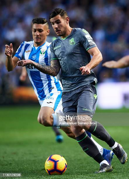 Oscar Rodriguez of CD Leganes duels for the ball with Theo Hernandez of Real Sociedad during the La Liga match between Real Sociedad and CD Leganes...