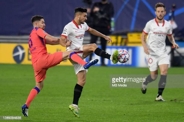 Oscar Rodriguez of FC Sevilla and Jorginho of Chelsea FC during the UEFA Champions League Group E stage match between FC Sevilla and Chelsea FC at...