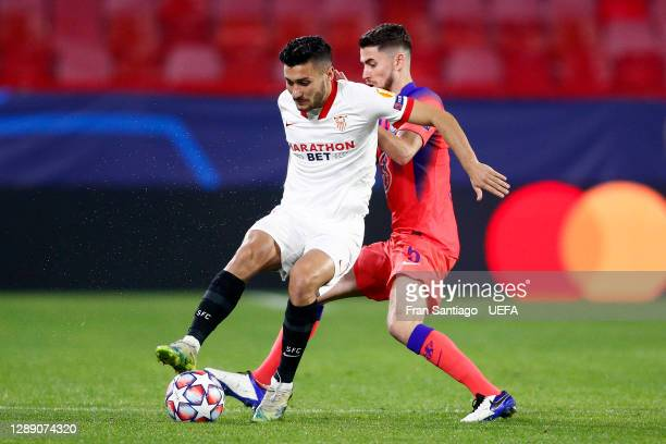 Oscar Rodriguez of FC Sevilla is tackled by Jorginho of Chelsea during the UEFA Champions League Group E stage match between FC Sevilla and Chelsea...