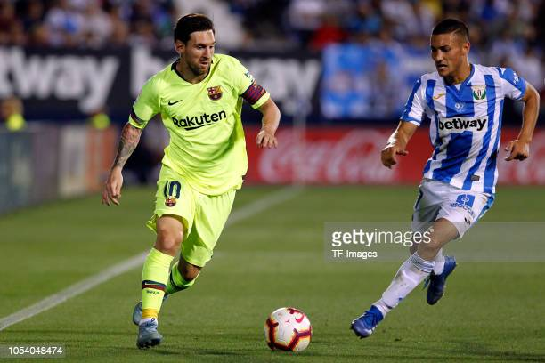 Oscar Rodriguez of Leganes and Lionel Messi of Barcelona battle for the ball during the La Liga match between CD Leganes and FC Barcelona at...