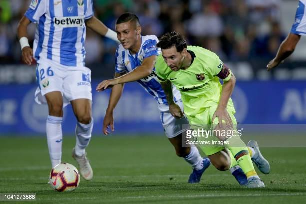Oscar Rodriguez of Leganes Lionel Messi of FC Barcelona during the La Liga Santander match between Leganes v FC Barcelona at the Estadio Municipal de...