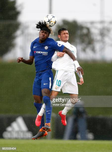 Oscar Rodriguez of Real Madrid competes for the ball with Trevoh Chalobah of Chelsea during the UEFA Youth League Quarterfinal match between Real...