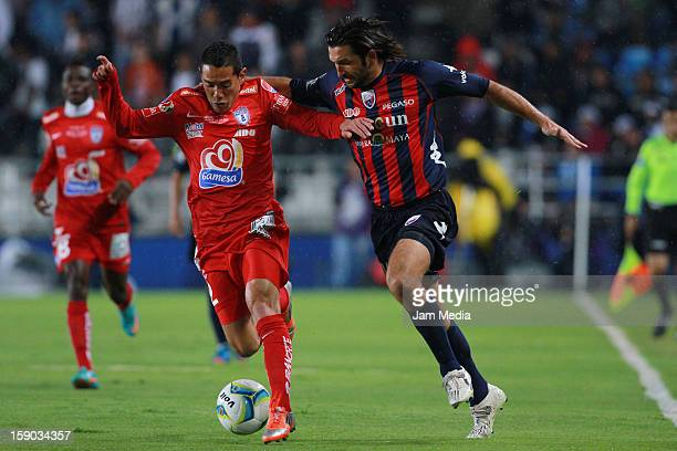 Oscar Rojas of Pachuca struggles for the ball with Francisco Fonseca of Atlante during a match between Pachuca v Atlante as parte of the Clausura...