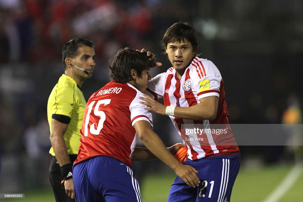 Oscar Romero of Paraguay celebrates with his teammate Angel Romero after scoring the first goal of his team during a match between Paraguay and Chile as part of FIFA 2018 World Cup Qualifiers at Defensores del Chaco Stadium on September 01, 2016 in Asuncion, Paraguay.