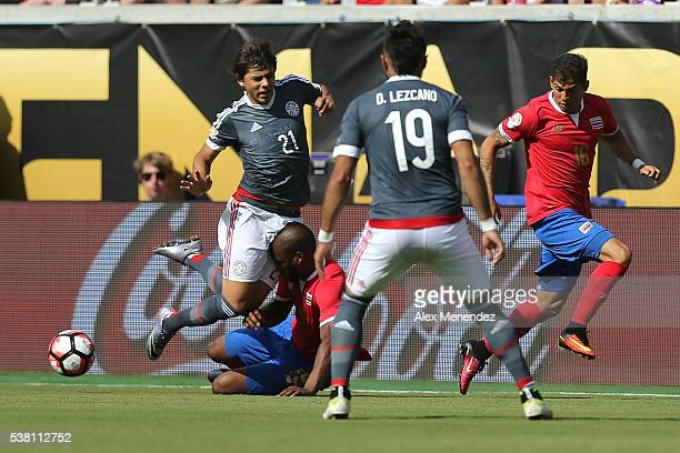 Oscar Romero of Paraguay gets stopped by Kendall Watson of Costa Rica during the 2016 Copa America Centenario Group A match between Costa Rica and...