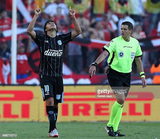 Oscar Romero of Racing Club celebrates after scoring the second goal of his team as referee German Delfino speaks to him during a first leg match...