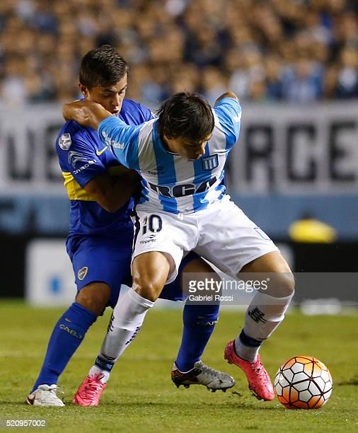 Oscar Romero of Racing Club fights for the ball with Adrian Andres Cubas of Boca Juniors during a match between Racing and Boca Juniors as part of...