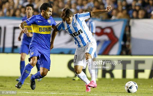 Oscar Romero of Racing Club fights for the ball with Carlos Tevez of Boca Juniors during a fifth round match between Racing Club and Boca Juniors as...