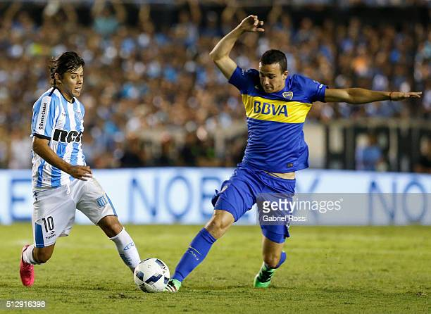 Oscar Romero of Racing Club fights for the ball with Leonardo Jara of Boca Juniors during a fifth round match between Racing Club and Boca Juniors as...