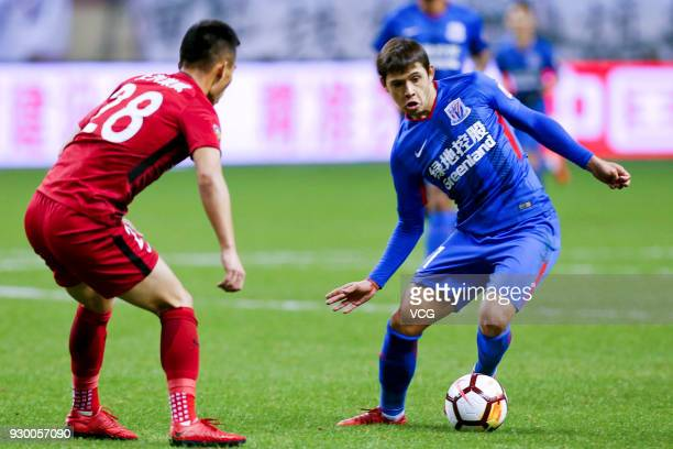 Oscar Romero of Shanghai Greenland Shenhua and He Guan of Shanghai SIPG compete for the ball during the 2018 Chinese Football Association Super...