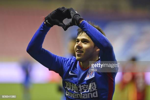 Oscar Romero of Shanghai Shenhua celebrates after scoring a goal during the 2018 Chinese Football Association Super League first round match between...