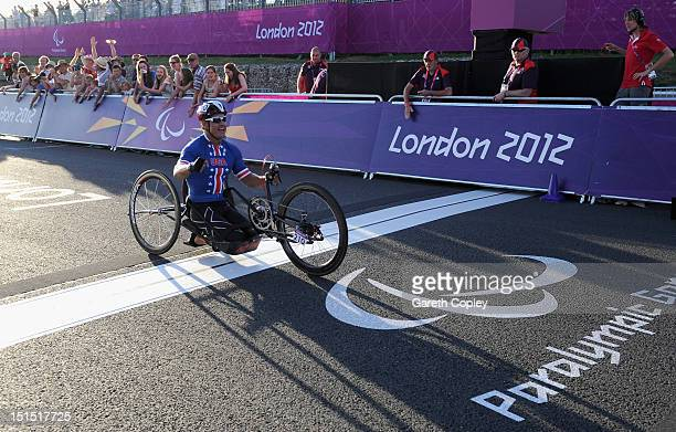 Oscar Sanchez of USA crosses the line to win gold in the Mixed H 14 relay on day 10 of the London 2012 Paralympic Games at Brands Hatch on September...