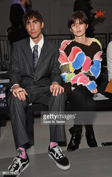 Oscar Scheller and Lara Mullen attend the Christopher Raeburn show during London Fashion Week Men's January 2018 at BFC Show Space on January 7 2018...