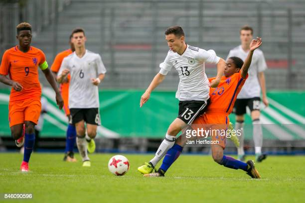 Oscar Schoenfelder of Germany and Crysencio Summerville of the Netherlands battles for the ball during the 'Four Nation' match between U17 Germany...