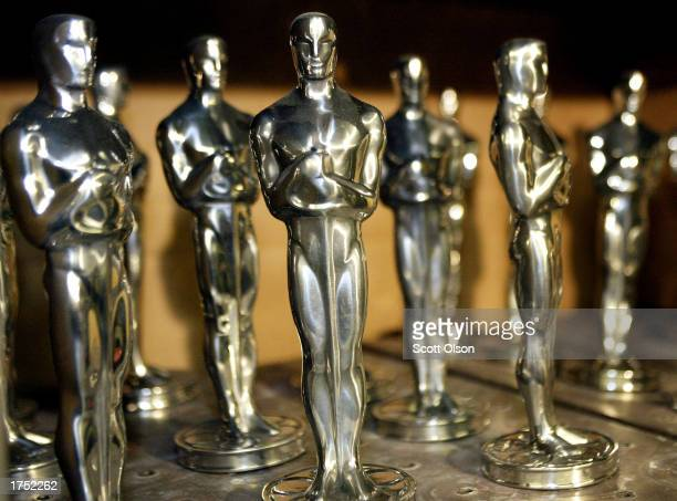 Oscar statues sit on a shelf prior to being polished during the manufacturing process at R S Owens and Company on January 29 2003 in Chicago Illinois...