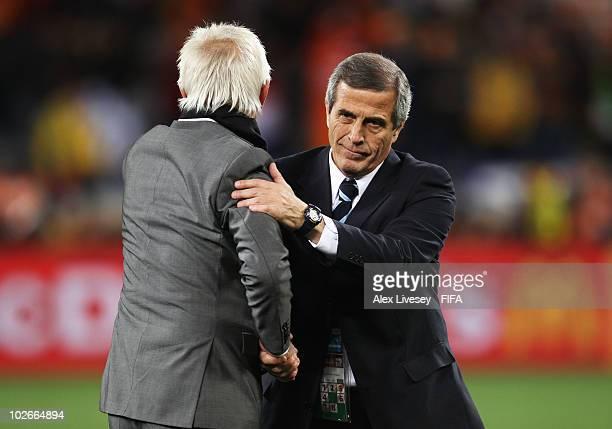 Oscar Tabarez head coach of Uruguay congratulates Bert van Marwijk head coach of the Netherlands after the 2010 FIFA World Cup South Africa Semi...