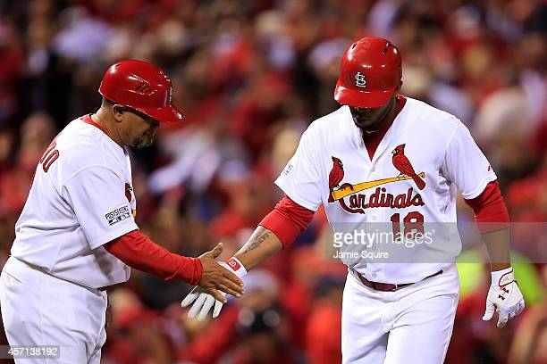 Oscar Taveras of the St Louis Cardinals celebrates hitting a solo home run in the seventh inning against the San Francisco Giants with third base...