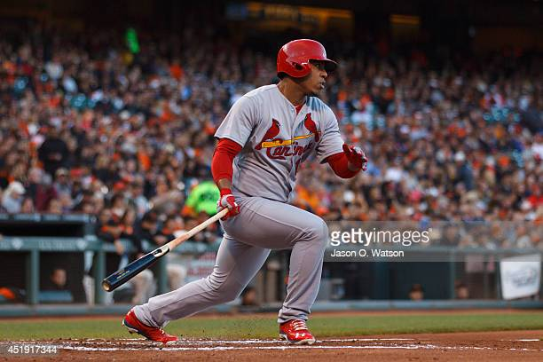 Oscar Taveras of the St Louis Cardinals hits a double against the San Francisco Giants during the third inning at ATT Park on July 2 2014 in San...