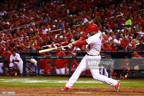 Oscar Taveras of the St Louis Cardinals hits a solo home run in the seventh inning against the San Francisco Giants during Game Two of the National...