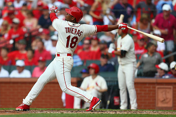 Oscar Taveras of the St. Louis Cardinals hits a solo...