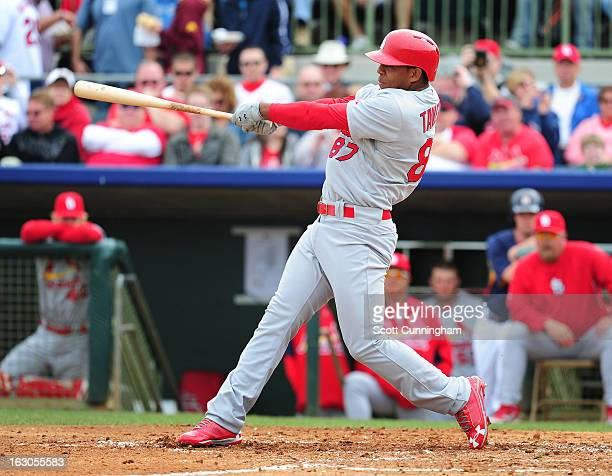 Oscar Taveras of the St Louis Cardinals hits during a spring training game against the Houston Astros at Osceola County Stadium on March 1 2013 in...