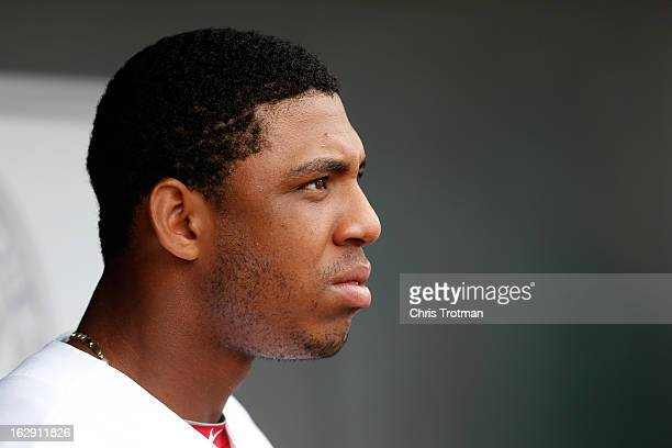 Oscar Taveras of the St Louis Cardinals looks on from the dugout against the Miami Marlins at Roger Dean Stadium on February 28 2013 in Jupiter...