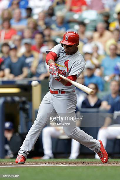 Oscar Taveras of the St Louis Cardinals makes some contact at the plate during the game against the Milwaukee Brewers at Miller Park on July 12 2014...