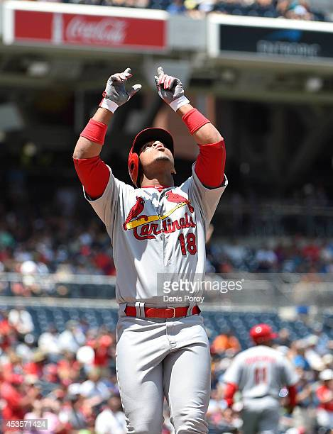 Oscar Taveras of the St Louis Cardinals points skyward after hitting a home run during a baseball game against the San Diego Padres at Petco Park...