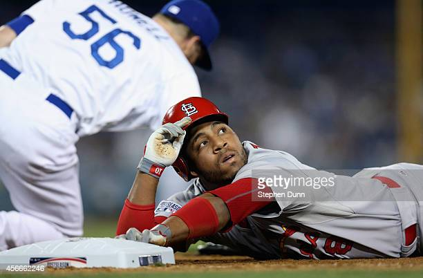 Oscar Taveras of the St Louis Cardinals signals to the umpire that he was safe in the eighth inning against the Los Angeles Dodgers in Game Two of...