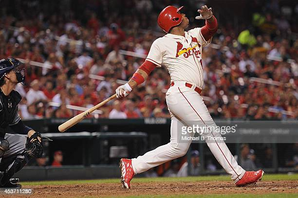 Oscar Taveras of the St Louis Cardinals singles in the sixth inning against the San Diego Padres at Busch Stadium on August 16 2014 in St Louis...